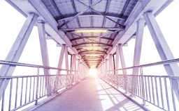 Light from the way out of modern metal structure bridge Stock Photos