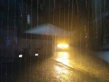 The light way. Raining. Light reflexion dark night Stock Photos