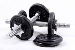 Light Weight Dumbbell. Light weighted 5kg pair of dumbbells isolated on white background Stock Photos