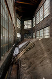 Light Well with Windows - Abandoned Factory. An impressive light well with intact windows inside an abandoned factory Stock Photo