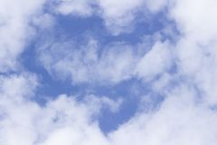 Light white clouds in the sky in the shape of a heart stock image