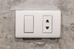 Light white switches on concrete wall Stock Image