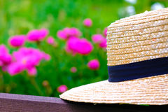 Light wicker hat. Good quality photo of a classic wicker hat: you may see classic broad-brimmed hat with navy blue fabric strip around it; the hat is made of stock photography
