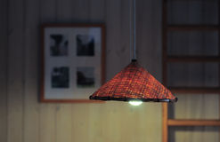 Light of wicker lamp at home in evening Royalty Free Stock Photo