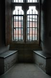 Light by the window. Benches in the London Tower royalty free stock image