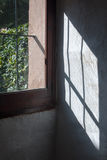 Light through window on a stone wall Royalty Free Stock Image