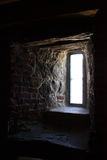 Light from window in thick stone wall Royalty Free Stock Photo