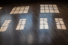 light from windows on an old wood floor Royalty Free Stock Image