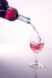 Light wine poured into wine glass Royalty Free Stock Photo