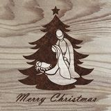 Christmas tree with nativity scene engraved on wood with pyrography technique. Hobby. DIY. Do it yourserlf stock images