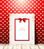 Light wood frame on red wall with white polka dots. Royalty Free Stock Images