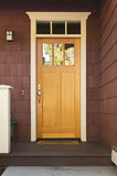 Light wood front door on a home Royalty Free Stock Images