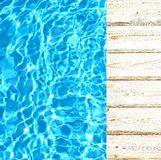 Light wood skirting or pier at the pool or the sea. Clear blue water with the flare texture. Stock Images