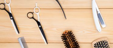 Light wooden background, are objects for cutting hair and beard and styling, combs. On a light wooden background, are objects for cutting hair and beard and stock photos