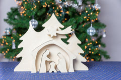 Light wooden christmas crib with Joseph and Mary Stock Photography