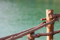 Light wooden fence with the blurred sea backdrop background with copy space. Light wooden fence with the blurred sea backdrop background on the island of Stock Photo