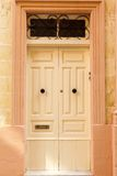 Light  wooden front door to the house. In the Mediterranean Stock Images
