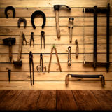Light wooden wall with different vintage carpentry tools. Backgr Royalty Free Stock Image