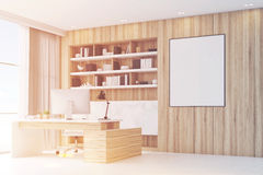 Light wooden workplace with table, side, tened. Side view of a light wooden workplace with a table, a desktop standing on it and a bookcase behind it. Poster on Stock Image