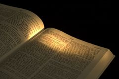 The Light of the World. Closeup of a part of the Bible. On dark background. Lamp on the text I Am The Light Of The World by Jesus stock photography