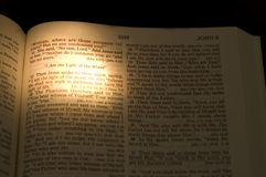 The Light of the World -2. Closeup of the Bible. On dark background. Lamp on the text I Am The Light Of The World by Jesus stock images