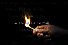 Light of the World. Woman's hand holding a blazing match which lights Religious/Christian text: Faith Hope Love ~ The Way The Truth The Life ~ For unto you is stock photo