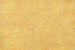 Light yellow background of dense woven bagging fabric, closeup. Structure of the textile macro. Royalty Free Stock Photography