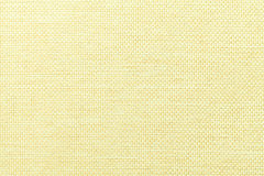 Light yellow background of dense woven bagging fabric, closeup. Structure of the textile macro. Stock Photography