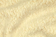 Light yellow crumpled luxury cashmere background. Stock Photo