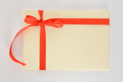 Light yellow envelope with a red ribbon on a white background Stock Photography