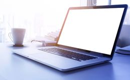 Light yellow filter effect Laptop with blank screen on desk table office. Light yellow filter effect Laptop with blank screen on desk with big window in modern stock image