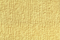 Light yellow fluffy background of soft, fleecy cloth. Texture of textile closeup. Royalty Free Stock Photos