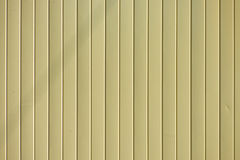 Light yellow goffered metal texture. Corrugated steel background Royalty Free Stock Image