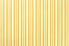 Light yellow and golden background from wrapping striped paper stock photos