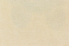Light yellow knitted  fabric texture or background Royalty Free Stock Photos