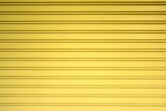 Light yellow metal sheet slide door texture background. Stock Photography