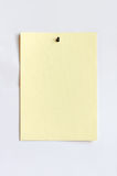 Light yellow sheet attached with pushpin Stock Photos