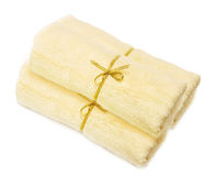 Light yellow towels. Pile a light yellow towels isolated on a white background Royalty Free Stock Photo