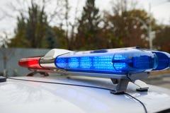 Lightbar av en nöd- polisbil Arkivfoto