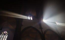 Lightbeams falling through the windows. Of the dark dome Royalty Free Stock Photo