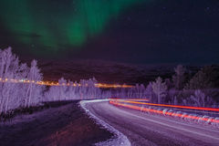Lightbeams under the Northern Lights Royalty Free Stock Image