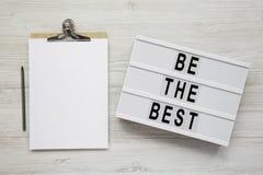 Lightbox与'是最佳的'词,有空白的纸片的剪贴板白色木表面上的 平的位置,顶上,顶视图, 库存图片