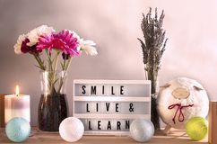 Lightbox candle and home decorations with inspirational message royalty free stock photos