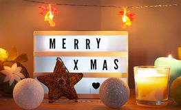 Merry X-mas lightbox and Christmas decorations with star stock photography