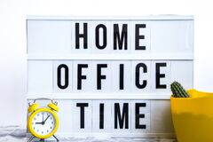 Free Lightbox With Text HOME OFFICE TIME In Front Concrete Background, With Cactus Notebook And Pen Alarm Clock Copy Space, Banner For Royalty Free Stock Photos - 180014378