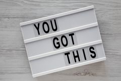 Lightbox with `You got this` words over white wooden background, top view. Business concept. Overhead, from above. Flat lay. Clo. Lightbox with `You got this` stock images