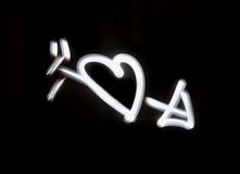 Lightbrushed Heart With Arrow. Heart and Armor�s arrow painted with light on long time exposure of camera (bulb mode). This kind of photography is called Stock Photos