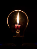 Lightbulb και φλόγα Στοκ Φωτογραφία
