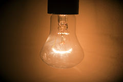 Lightbulb. Light shines on a dark background is the idea Royalty Free Stock Photography