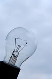 Lightbulb. With cloudy sky in background Stock Photos